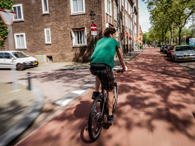 netherlands-cyclist-cycling-lane