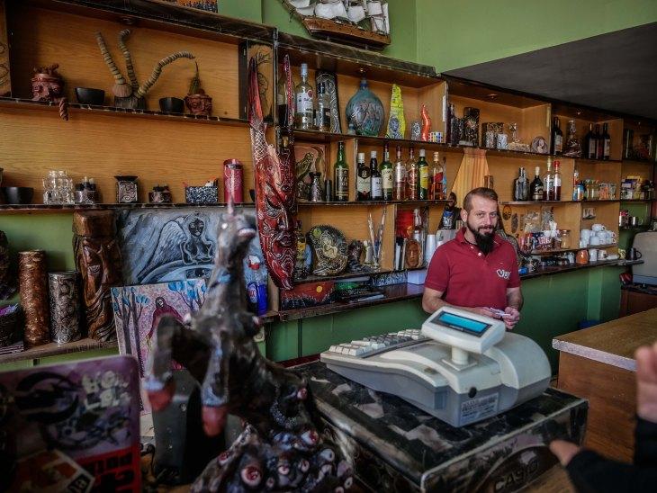 Christos is barman and artist